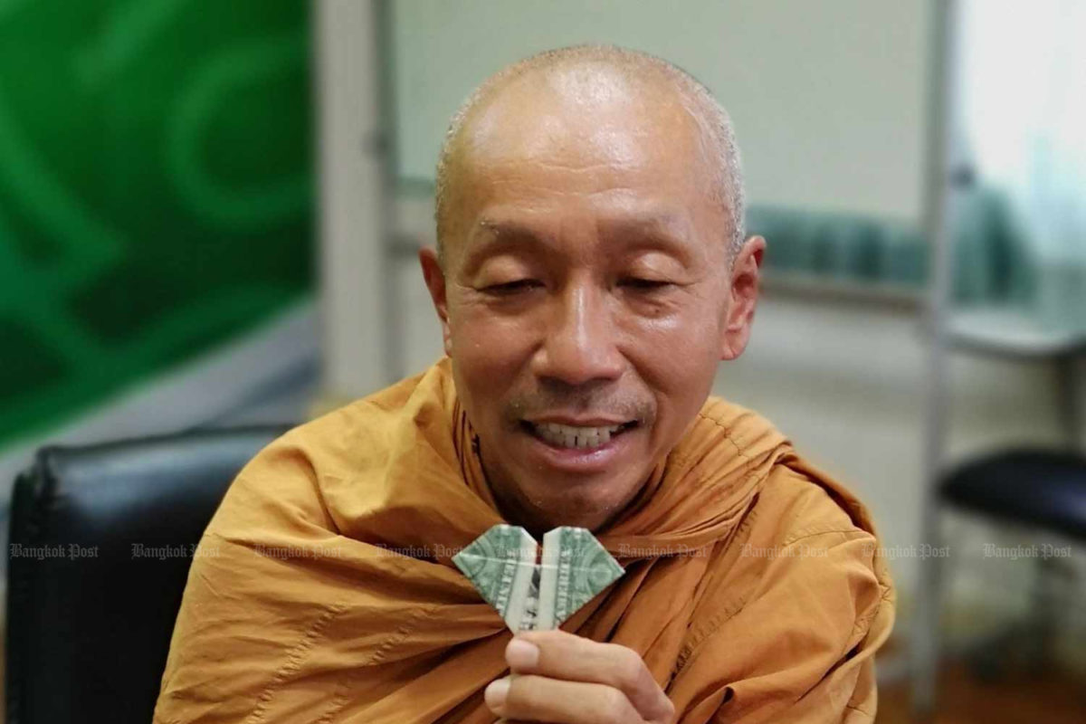'Peace walk' monk returns to Thailand