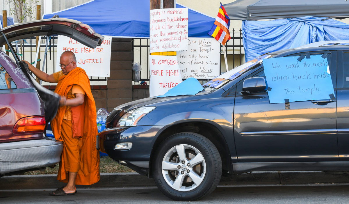 Dispute between Buddhist temple's board and its congregation leaves monks out in the streets.
