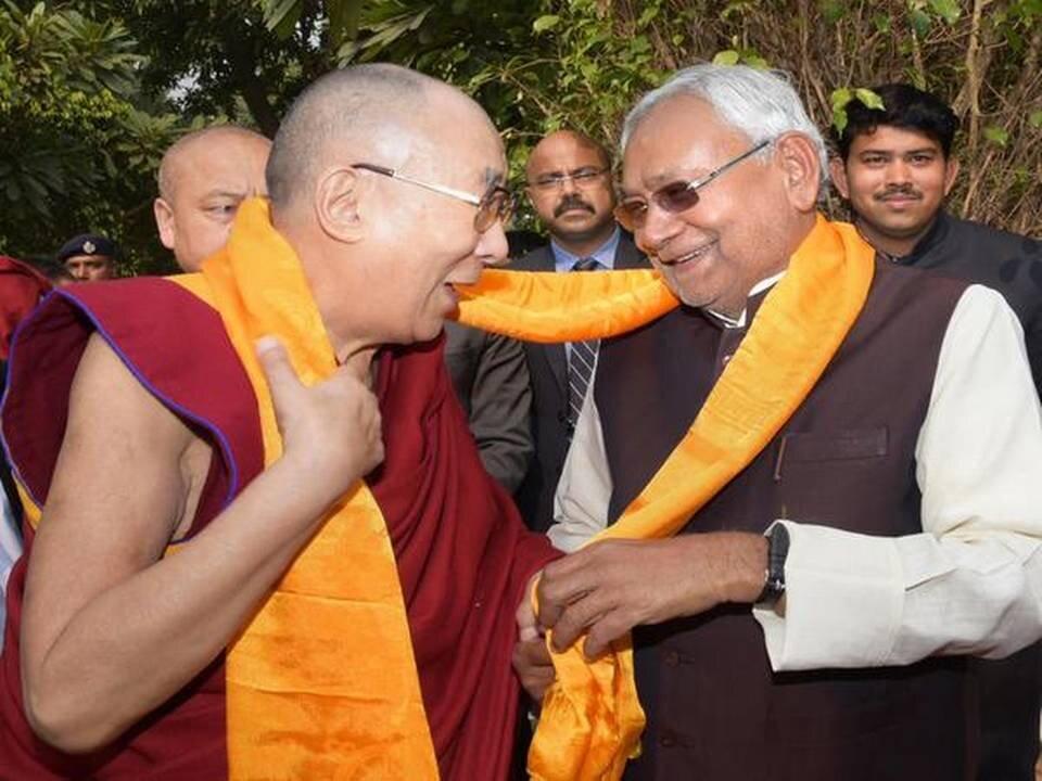 Dalai Lama visits Bihar CM's residence, prays for peace.